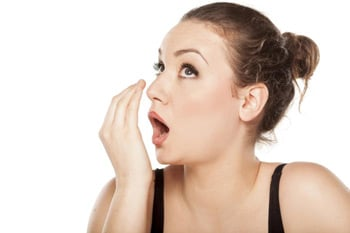 Woman Checking For Bad Breath