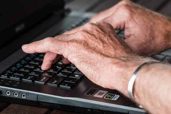 old hands on computer keys
