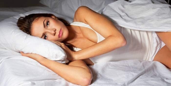 girl on bed wih eyes open