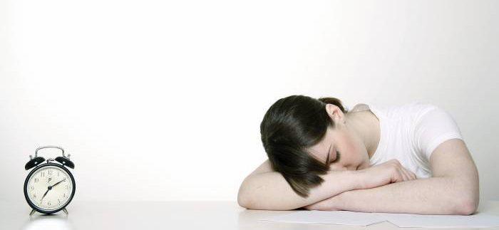 girl laying head on desk