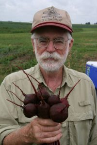 old farmer holding beets