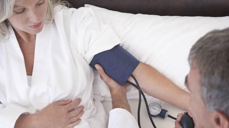 woman blood pressure being taking