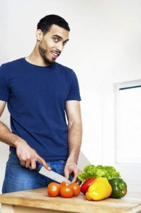 man cutting vegtables