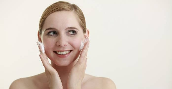 woman washingher face