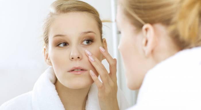 woman watching her skin