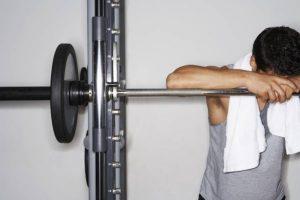 man tired at gym