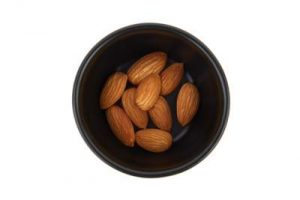 almonds in a black bowl