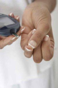 woman testing diabetics