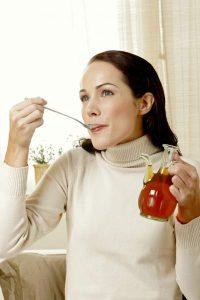 woman eating honey